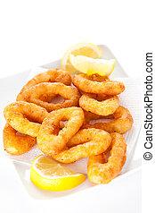 plate of tasty fried calamari with lemon