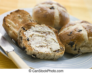 Plate of Toasted Hot Cross Buns with Butter