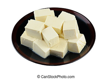 Plate of tofu - Close up of tofu on plate isolated on white