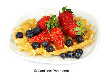 Plate of waffles with berries
