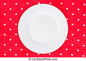 plate on a red tablecloth points