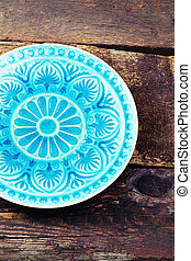plate on old vintage wooden background