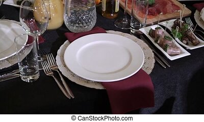 Plate on red napkin in restaurant at the party