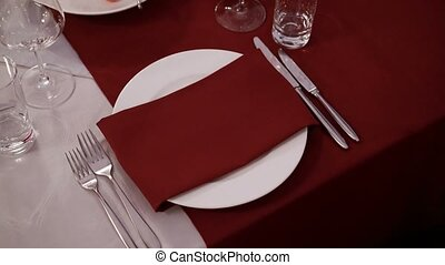 Plate on red tablecloth with red napkin