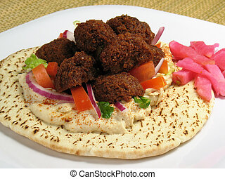 Plate w/ Falafels & - A delicious portion of falafels served...