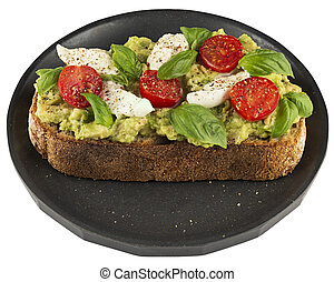 Plate with avocado, mozzarella and tomato sandwich isolated on white.