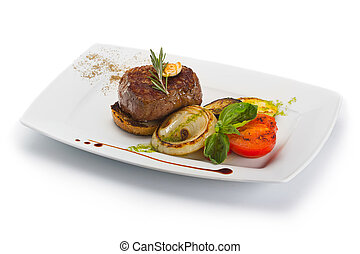 Plate with barbecue grilled beef steak meat with vegetables