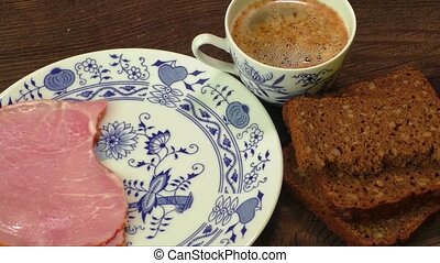 Plate with cheese,ham,cup of coffee
