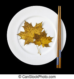 Plate with chopsticks and maple leaves