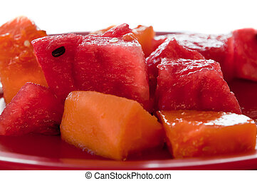 Plate with chunks of watermelon and papaya