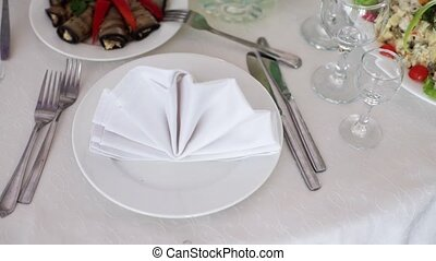 Plate with cloth white napkin in restaurant for event party