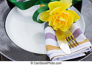 plate with cutlery and flower