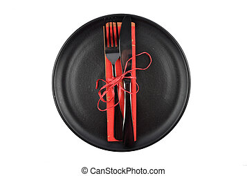 Plate with cutlery and napkin isolated