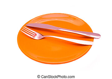 Plate with cutlery on a white background