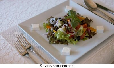 Plate with delicious Greek salad in the restaurant