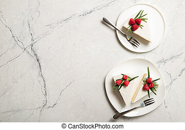Plate with delicious raspberry cheesecake. On a wooden background