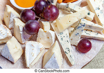 Plate with different cheeses - Board with different types of...