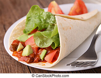 plate with fajita burrito - fajita burrito with beef and...