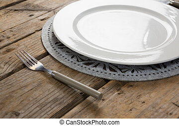 Plate with fork on wooden table