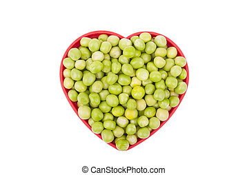 Plate with green peas isolated on a white background.
