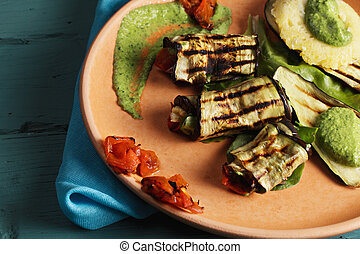 Plate with grilled eggplants closeup