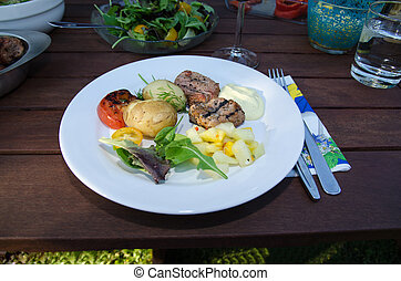 Plate with grilled meat