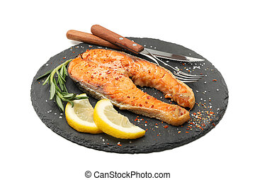 Plate with grilled salmon isolated on white background