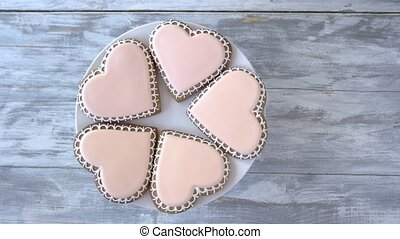 Plate with heart shaped cookies. Biscuits in a shape of...