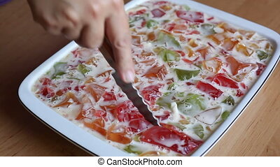 Plate with multi-colored Jelly. Video close-up, high quality