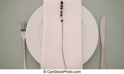 Plate with napkin and lavender closeup