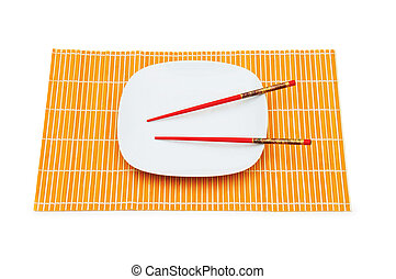 Plate with red chopsticks isolated on white