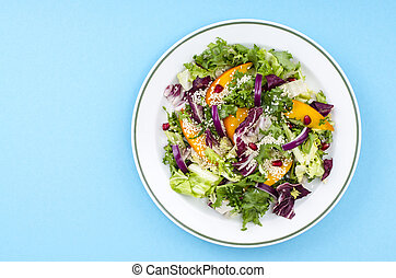 Plate with salad on bright background