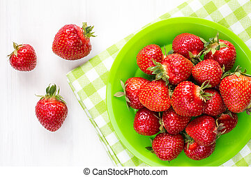 Plate with strawberries-top view.