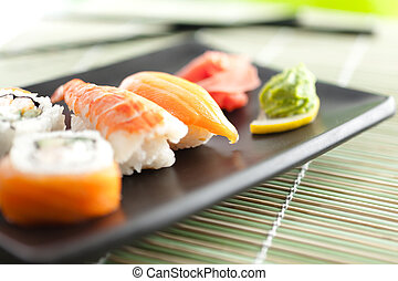 Plate with sushi, isolated on white