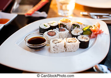 Plate with sushi rolls in the restaurant