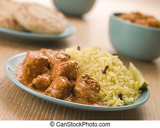 Plated Chicken Korma with Pilau Rice and Naan bread