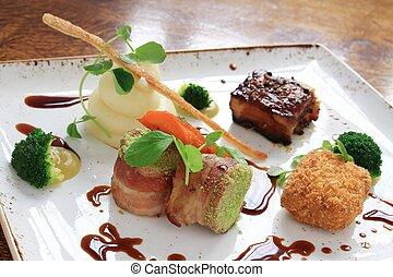plated pork dinner with vegetables