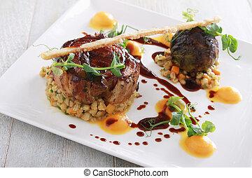 plated pork main meal - plated gourmet pork meal