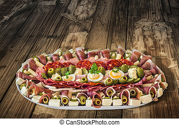 Plateful of Serbian Appetizer Meze on very old Wooden Table