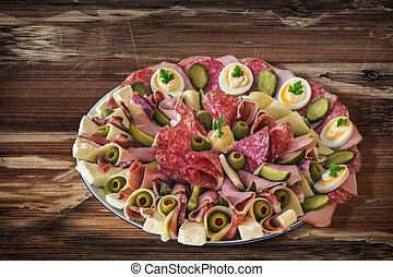 Plateful of Serbian Savoury Appetizer Meze on very old Wooden Table
