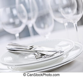 Plates and cutlery - Elegant restaurant table setting with...