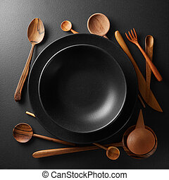 plates and wooden cutlery