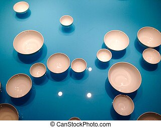 Plates floating on the water