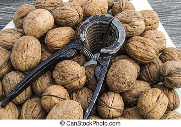 Plates of natural walnuts and walnut crumbs