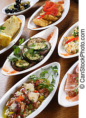 Plates of Spanish tapas - A table full of traditional...