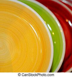 Plates - Various ceramic plates in a row closeup