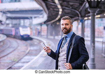 platfo, attente, train, hipster, homme affaires, smartphone