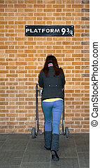 Platform 9 3/4 with person