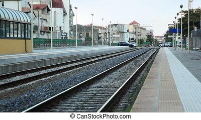 Platform and railway lines near train station - platform and...