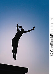 Platform diver - Silhouette of female diver jumping from...